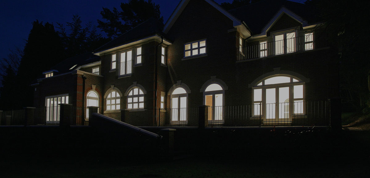 House at night with lights on