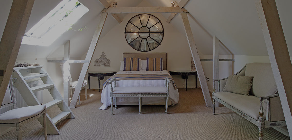 Attic room with bed